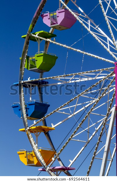 Close up of brightly colored Ferris Wheel cars at local summer carnival