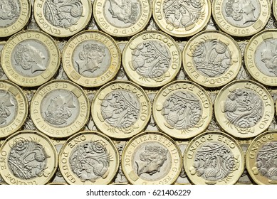 Close up of British money, new pound coins background laid flat. Overhead point of view. The bimetallic coin was introduced in March 2017. These coins are dated 2016.