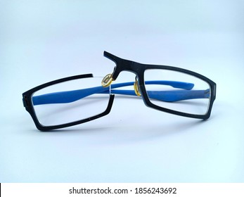 Close up of Broken blue eye glasses. Snapped in half. isolated on White Background.