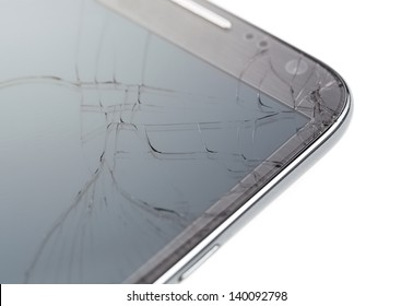 Close up of broken smart phone isolated on white background