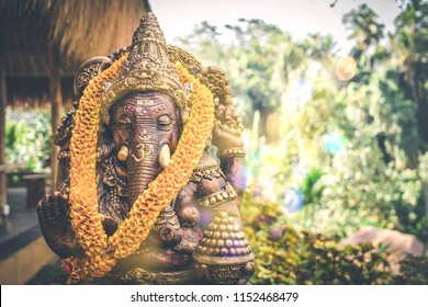 Close up Bronze Ganesha statue and Golden texture. Ganeshs is hindu god of Success. Bali island.