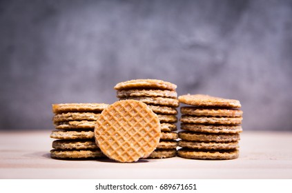 close up brown homemade stroopwafel snack on kitchen background made from daugh and syrub in original tast from dutch