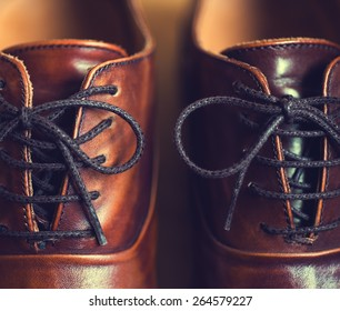 Close up of brown leather men's shoes