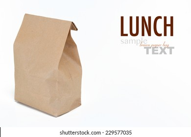 Close up of a brown lunch bag with sample text. Shot in studio and isolated on a white background.