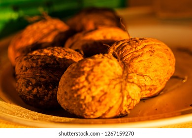 Close up brown walnuts, his bark with texture, organic food; note shallow depth of field