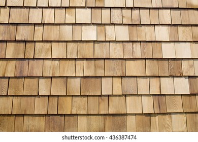 Close up of brown wood roof shingles.
