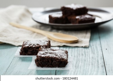 Close up of brownies with a wood spoon