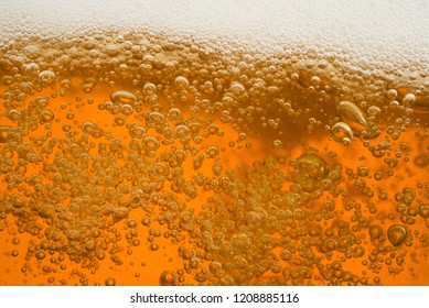 Close up Bubble froth of beer or water orange juice soda in glass