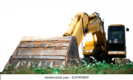 close up bucket backhoe on green lawn.Earthwork.bucket backhoe isolated on white background.equipment for construction.