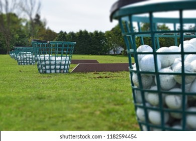 Close up bucket of practise or range balls at a golf course driving range.