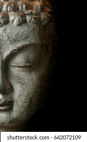 Close up Buddah statue with black copyspace
