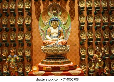 close up of buddha statue on the wall. chinese style buddha sculpture.
