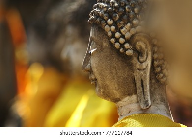 Close up of a Buddha statue at Wat Yai Chai Mongkol in Ayutthaya, Thailand.