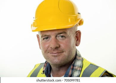 Close up of builder wearing a yellow hard hat.