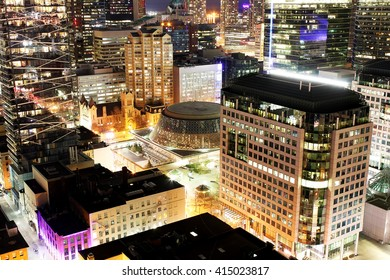 Close up of buildings and skyscrapers in downtown Toronto financial district at night