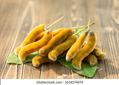 Close up bunch of Mucuna pruriens on wooden table