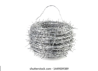Close up A bundle of Galvanized Barbed Wire or Barb Wire Fencing with sharp edges isolated on white background.