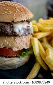 Close up of burger with french fries