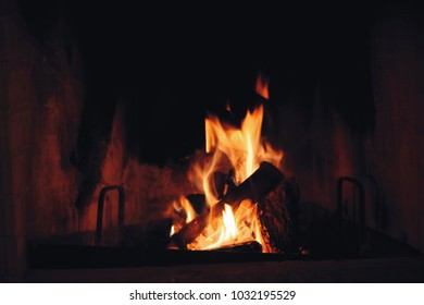 Close up of burning firewood in the fireplace.