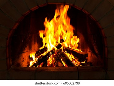 close up of Burning firewood in the fireplace