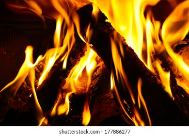 Close up of burning logs in a fireplace
