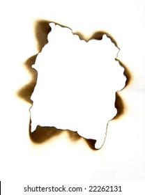 close up of burnt paper hole on white background