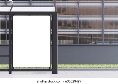 Close up of a bus stop with a blank vertical poster standing in a street near an office building. 3d rendering, mock up