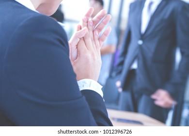 Close up business clap