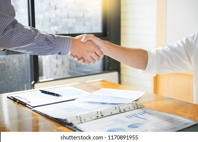 Close up of a business handshake, finishing up a meeting acquisition Greeting Deal concept