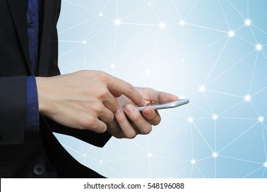 close up business man hand using smart phone against abstract technology infrastructure connecting backdrop for deal working business concept
