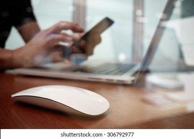 close up of business man hand working on laptop computer on wooden desk