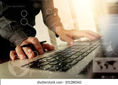 Close up of business man hand working with digital business layers diagram laptop computer on wooden desk as concept