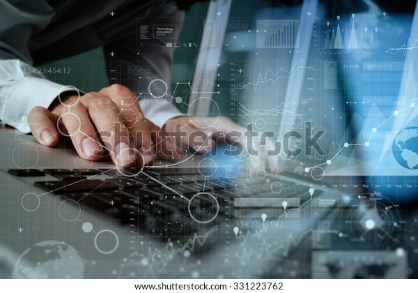 Close up of business man hand working on blank screen laptop computer on wooden desk as concept