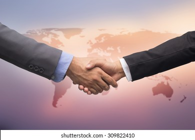 close up business man handshake over world map on blur background,start up entrepreneur executive meeting hand shaking concept