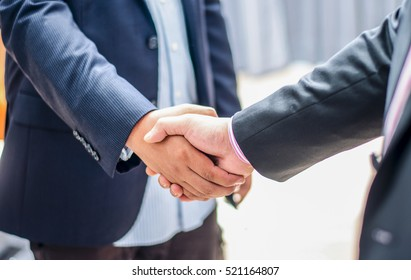 close up business man handshake together on blur meeting room background in :agreement,accept,approve financial cooperative concept.improve/development.trust,goal,team,hand,shake:international invest