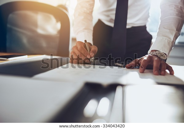 Close up business man signing contract making a deal, classic business