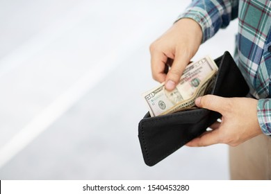close up business man standing  hand hold Count the money spread of cash. concept finance Saving money.  Leave space for writing text.