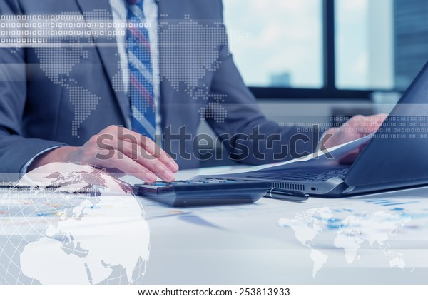 Close up of business man typing on laptop computer with technology layer effect, business globalization concept