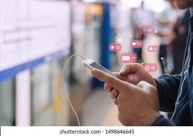 Close up of a business man using cell phone or  smartphone with  icons on train station or subway background ,Businessman using phone ,Social, media, Marketing concept .