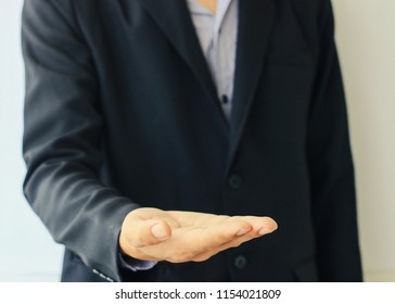 Close up of business mans hand showing something