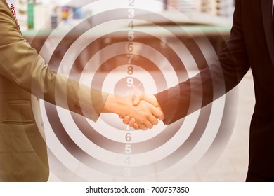 close up of  Business partnership meeting, Deal Handshake of business with partner join together with teamwork,Agreement and successful Concept on dart board background