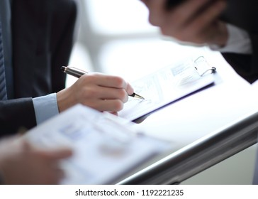 Close up of business people hands pointing growing financial bu