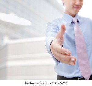 Close up of business people shaking hands over a deal at office - Indoors, model is a asian man