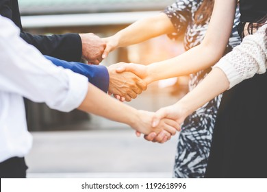 Close up of business People Team Success and handshake Partner Togetherness. Happiness company with happy or friends economists, students, financiers, lawyers or Volunteer shaking hand on city