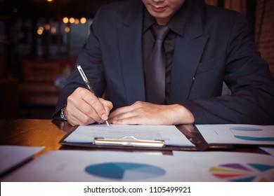 Close up of business person hand putting signing contract,running own small business,have a contract in place to protect it,signing of modest agreements form In office