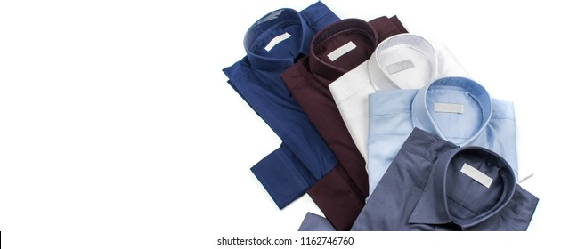 Close up of business suit or formal shirt or t shirt isolated on white with copy space for web banner or header design. Men's shirts set. Cloth folded on a white background. Color Gray, Dark blue, Red