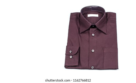 Close up of business suit or formal shirt or t shirt isolated on white with copy space for web banner or header design. Men's shirts set. Texture of Cloth folded on a white background. Color Dark red