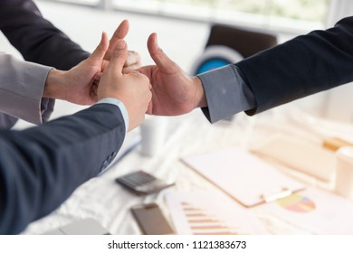 Close up business team and partners business are joining thumbs up together after agreement deal complete., Business concept