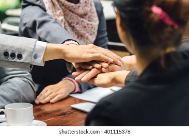 close up of business team showing unity with their hands together