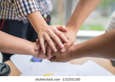 Close up of business teamwork consultations and meetings holding or standing hands together for successful in business, harmony,agreement,power and friendship concept.